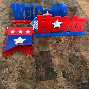 Welcome home red white and blue decor.